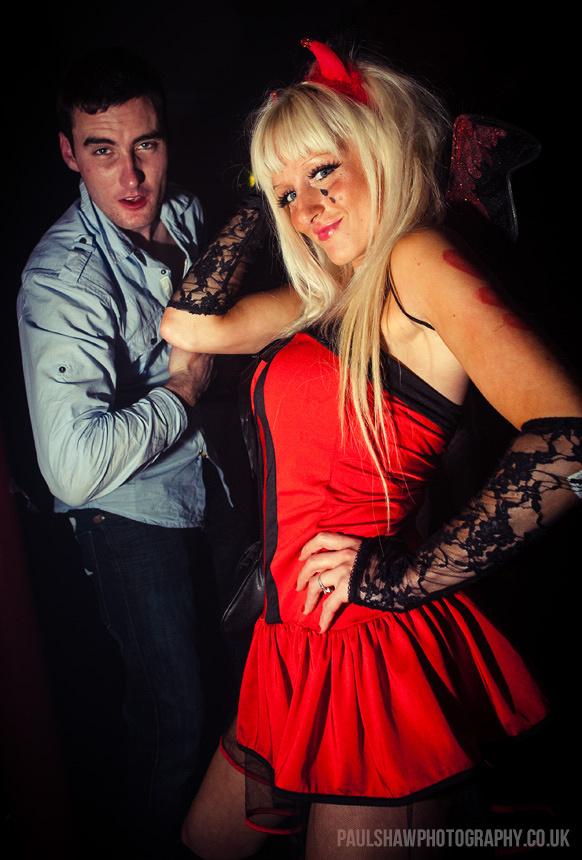 Two Clubbers in Fancy Dress in the Chapel Nightclub in Salisbury. The Female is dressed as a devil.