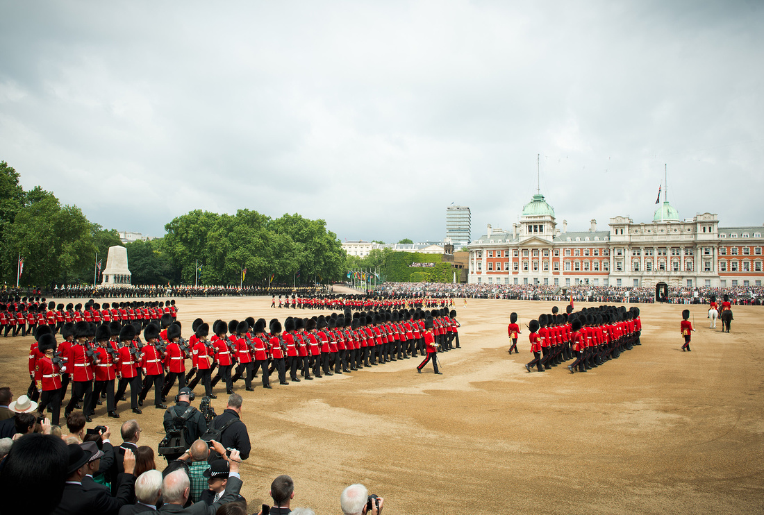 Foot Guards march past the crowds at the 2014 Trooping the Colour parade