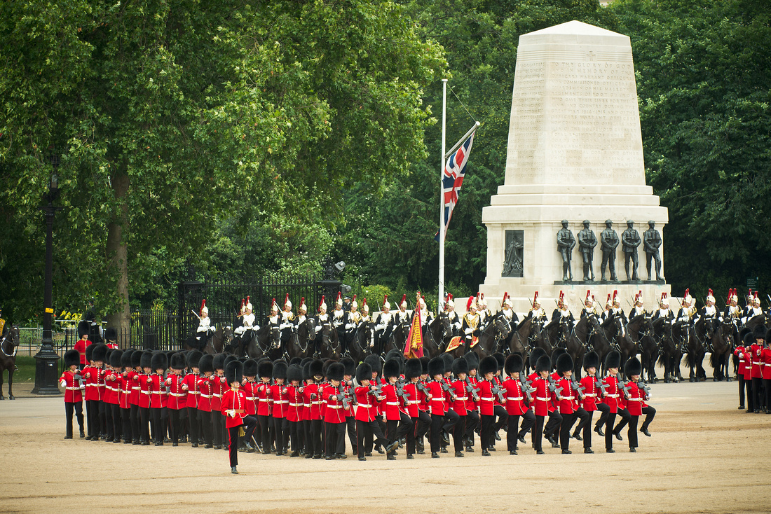 The Grenadier Guards form three ranks after trooping the Colour past Her Majesty the Queen