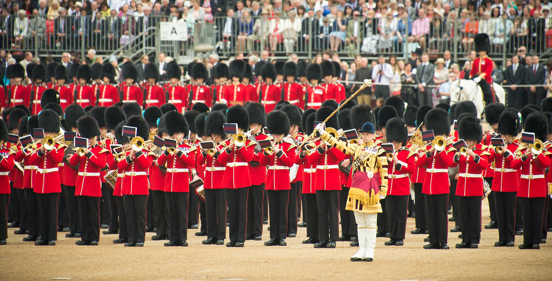 Senior Drum Major Colour Sergeant Scott Fitzgerald conducts the Foot Guards Massed Band